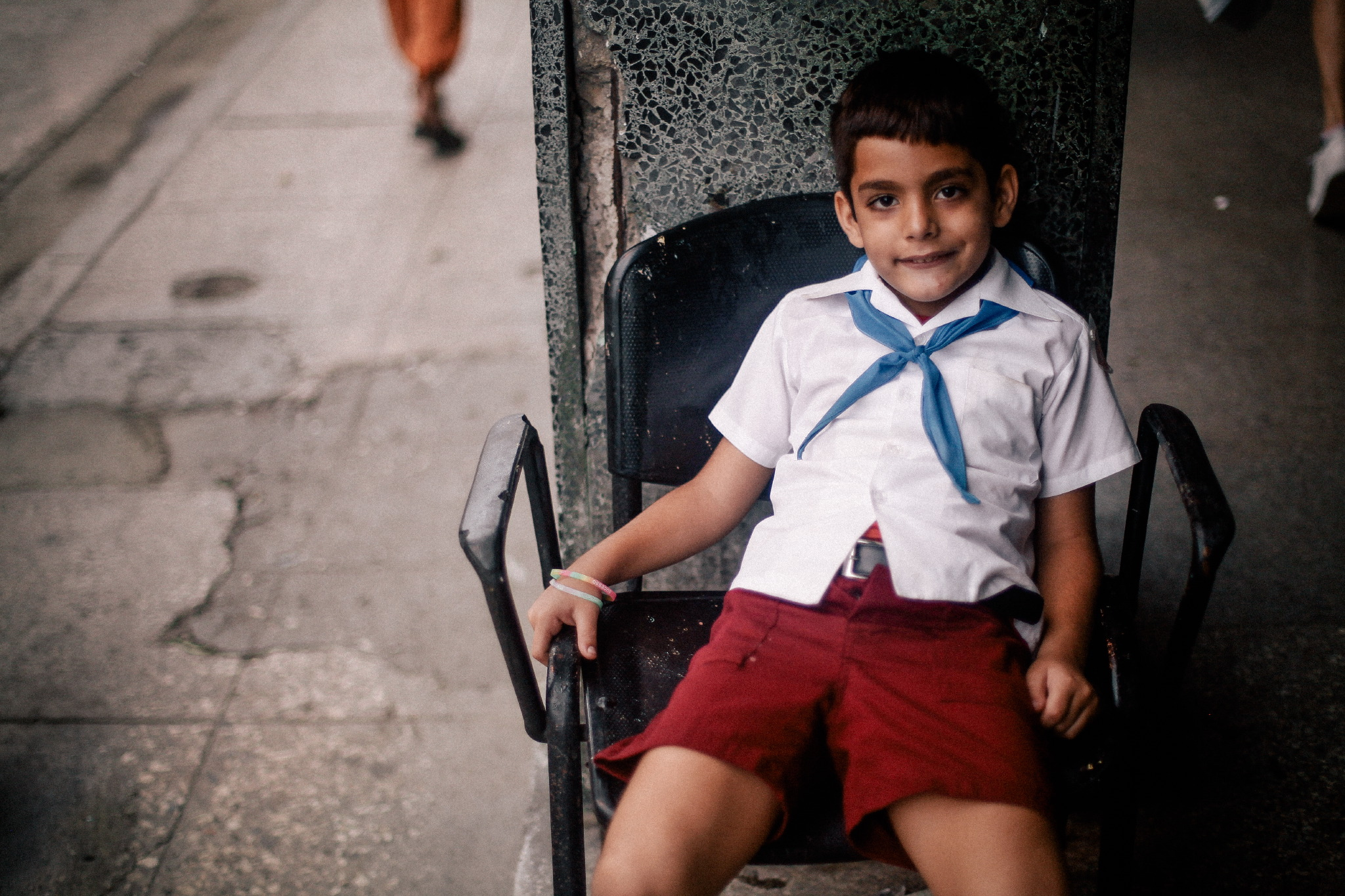 san diego wedding   photographer | child with blue handkerchief tied around neck sitting down