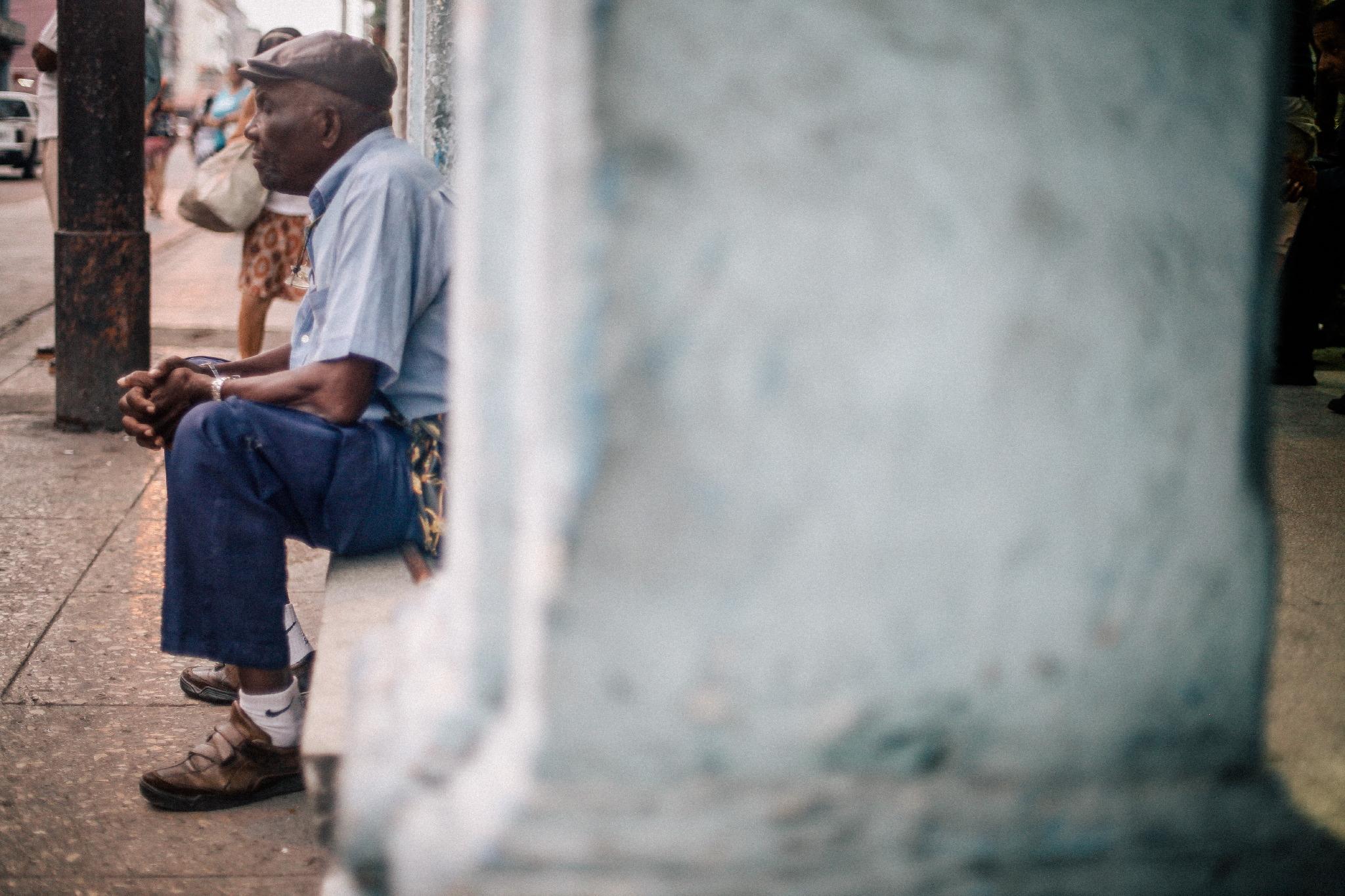 san diego wedding   photographer | shot of middle aged man sitting on windowsill