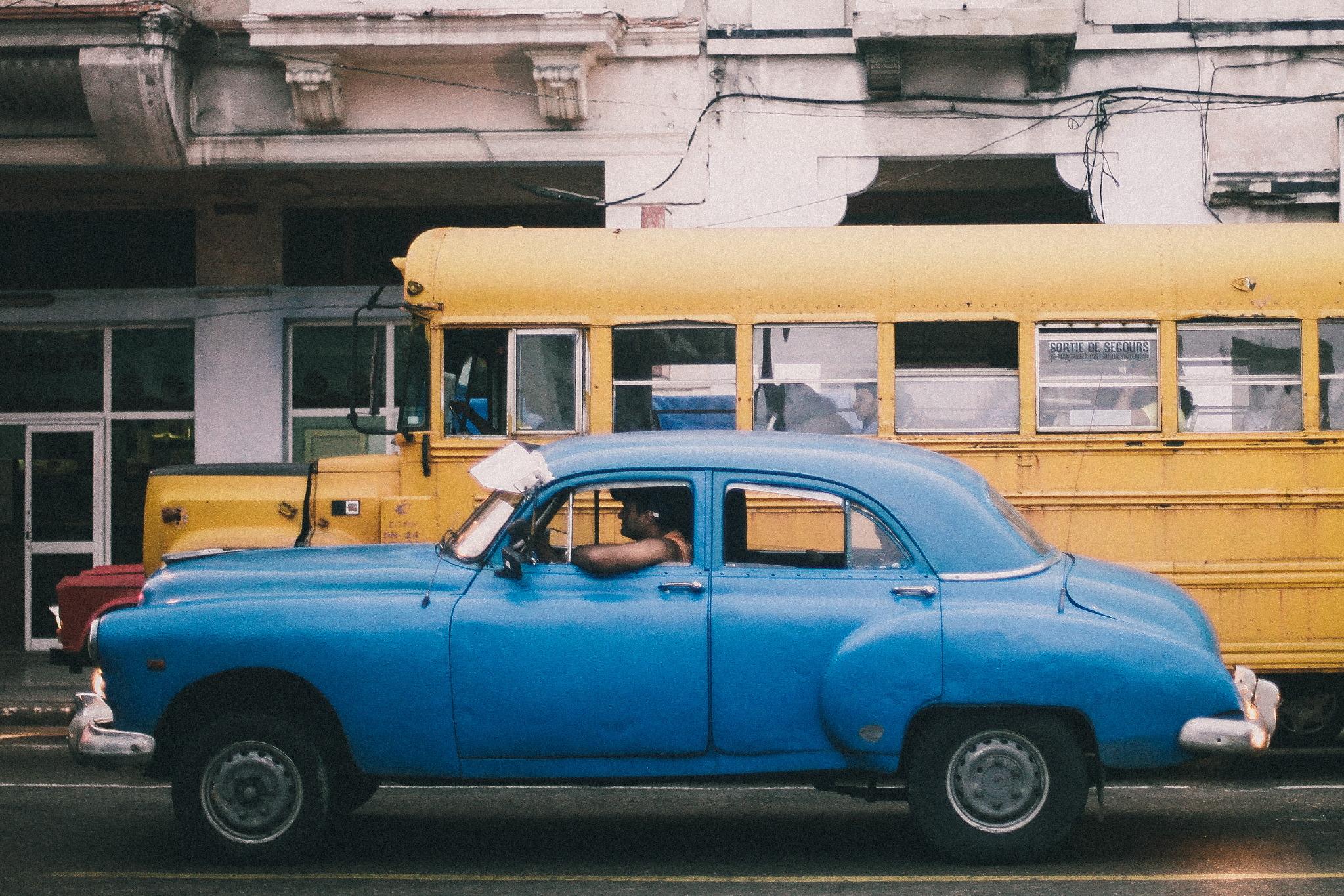 san diego wedding   photographer | blue car driving past yellow bus