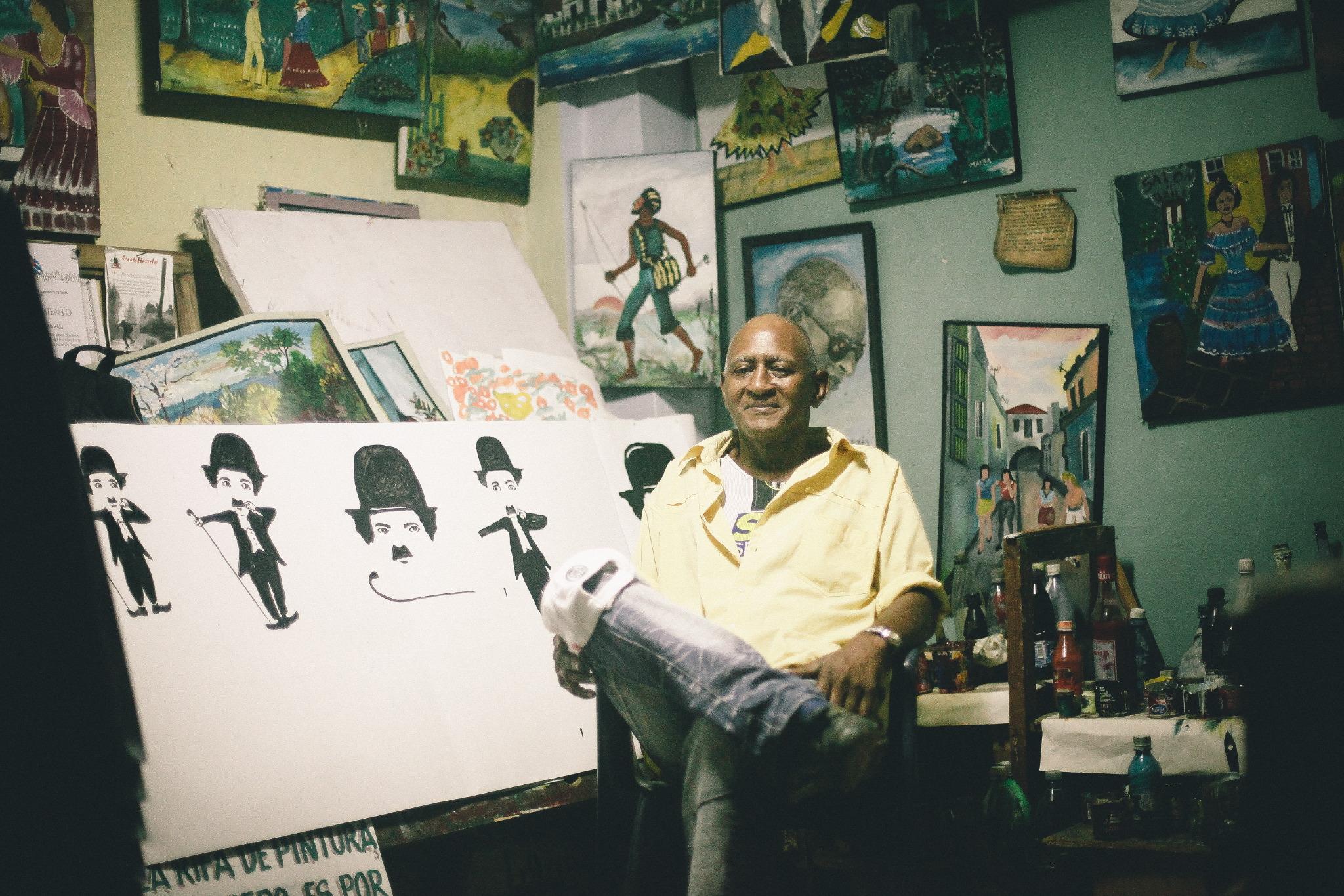 san diego wedding   photographer | artist sitting in front of his work in progress