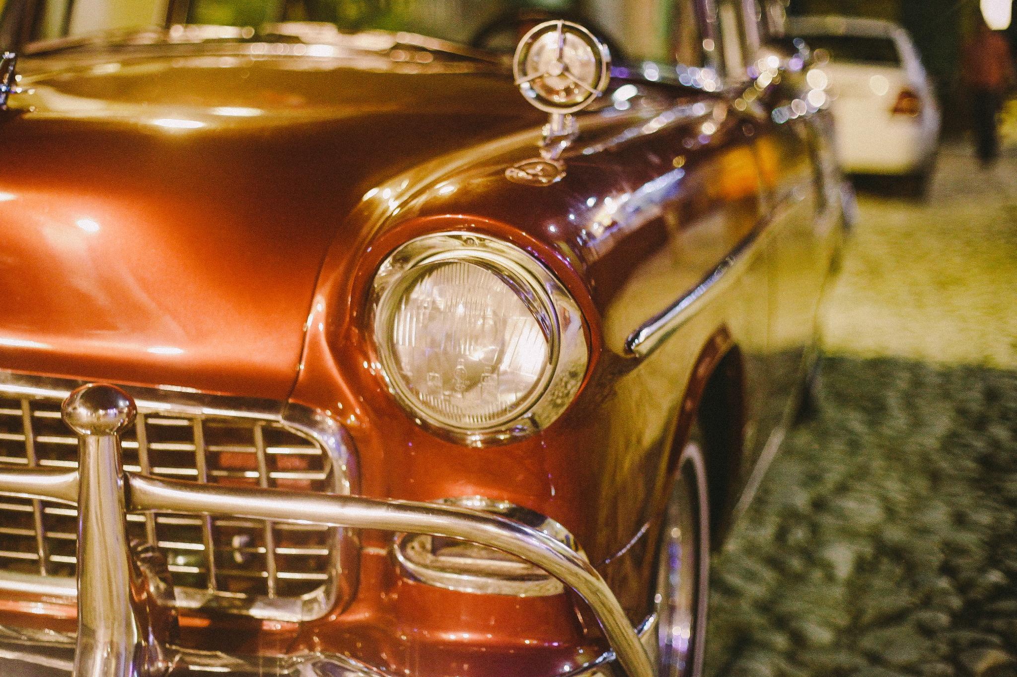 san diego wedding   photographer | shiny maroon colored car close up