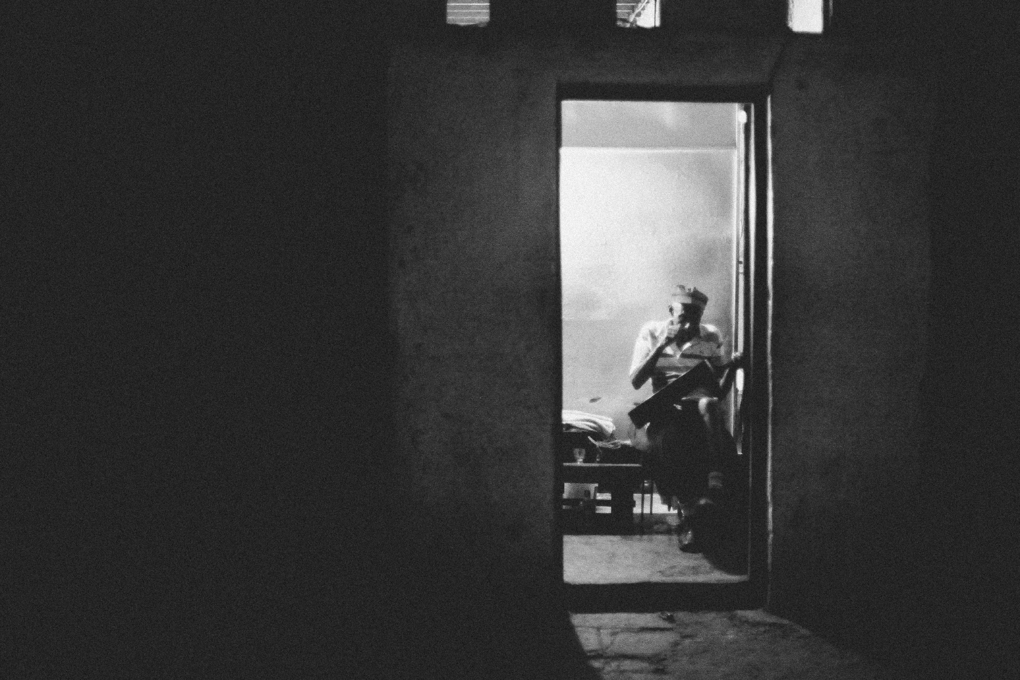san diego wedding   photographer | old man with guitar seen through doorway