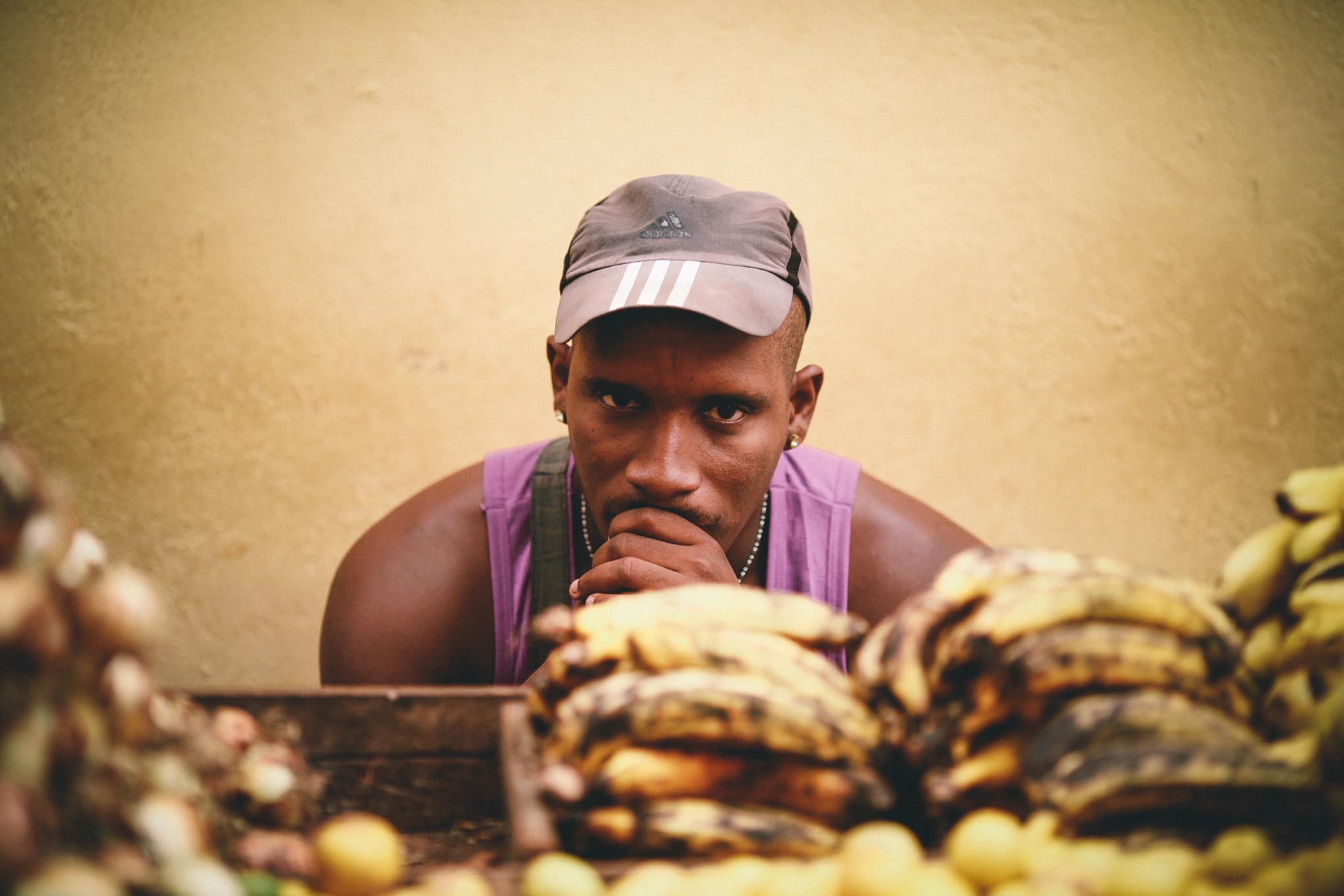 san diego wedding   photographer | man thinking deeply looking at bananas