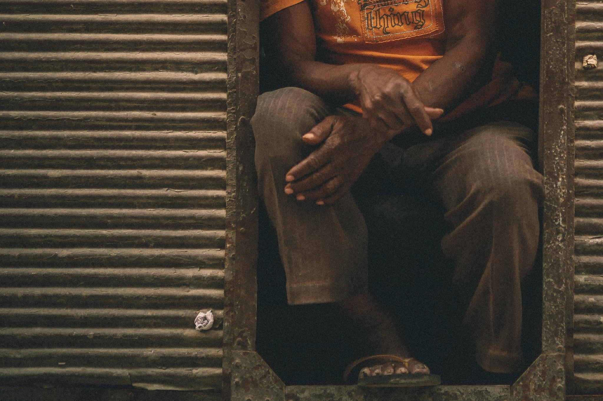 san diego wedding   photographer | man's lower body sitting by old metal gate