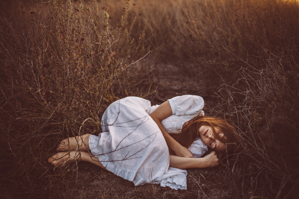 san diego wedding   photographer | long-haired brunette barefoot woman lying with eyes closed on   field