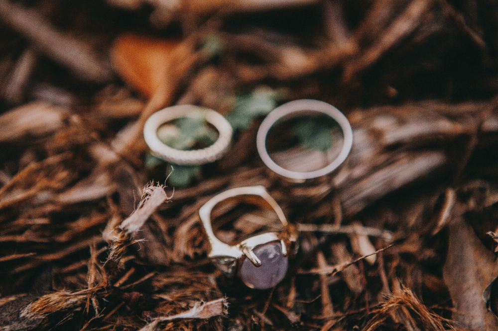 san diego wedding   photographer | rings laid down on floor with wood in background