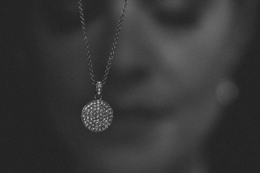 san diego wedding   photographer | monotone shot of necklace studded with diamonds