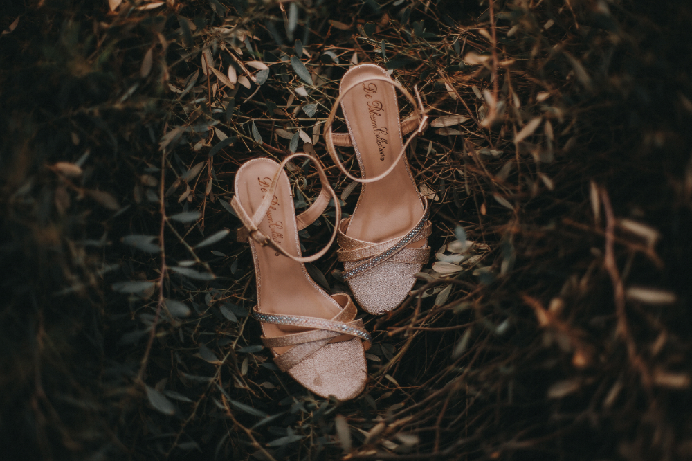 san diego wedding   photographer | woman's heels studded with jewels on floor filled with   vegetation