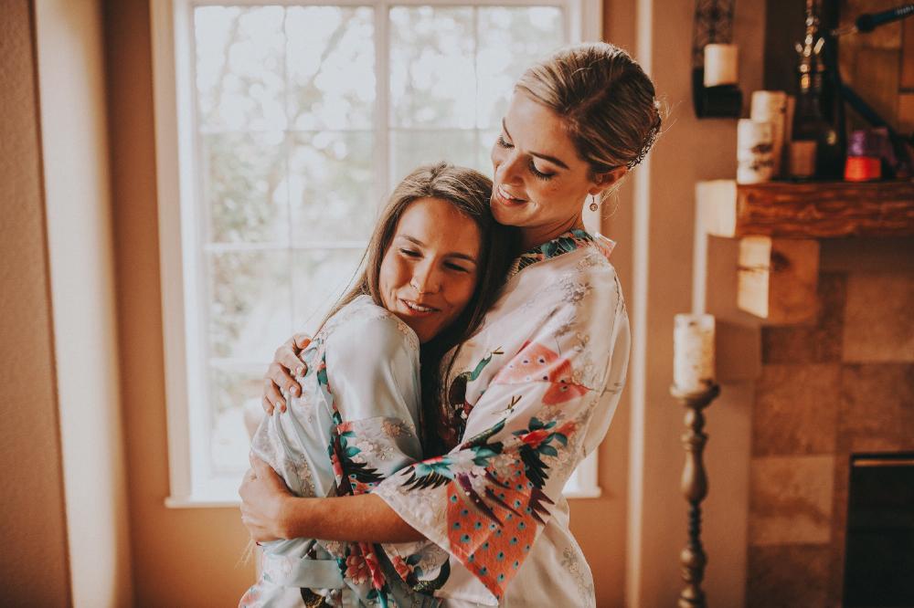 san diego wedding   photographer | women in floral kimonos hugging each other