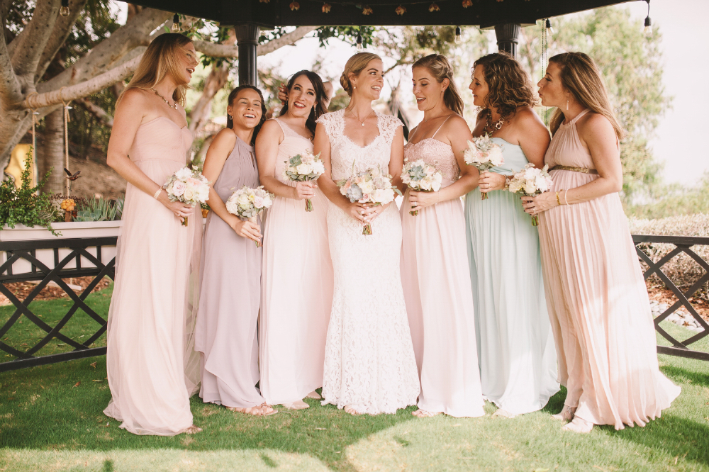 san diego wedding   photographer | women in pastel dresses lined up smiling with bouquets