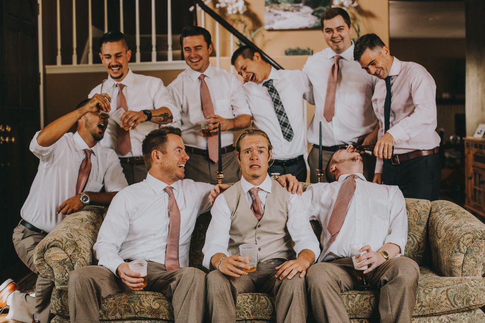 san diego wedding   photographer | groomsmen laughing with groom perplexed