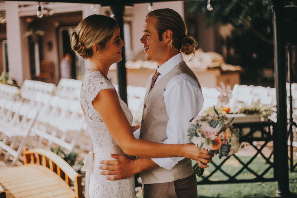 san diego wedding   photographer | bride and groom holding each other with bouquet under gazebo