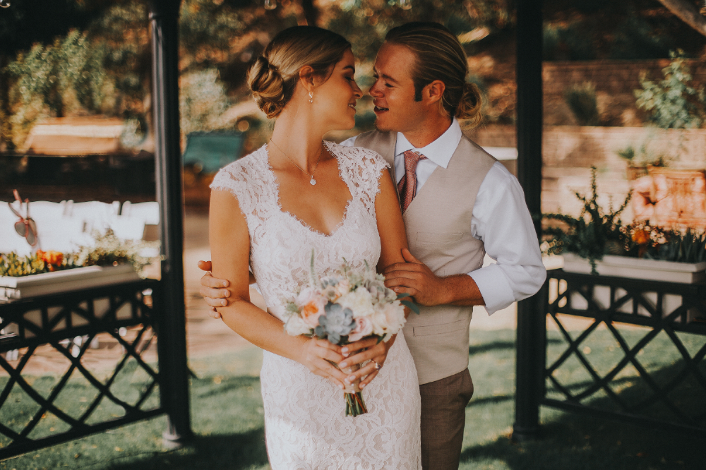 san diego wedding   photographer | bride about to kiss groom from behind in gazebo
