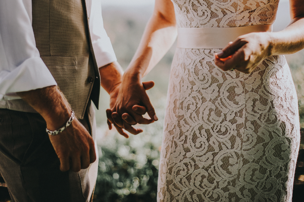 san diego wedding   photographer | closeup of bride and groom's lower body with hand   intertwined
