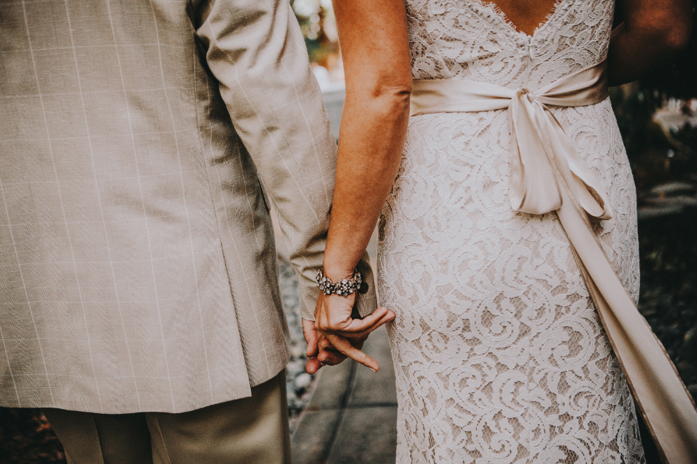 san diego wedding   photographer | closeup of newly wed couple's lower body from behind holding   hands