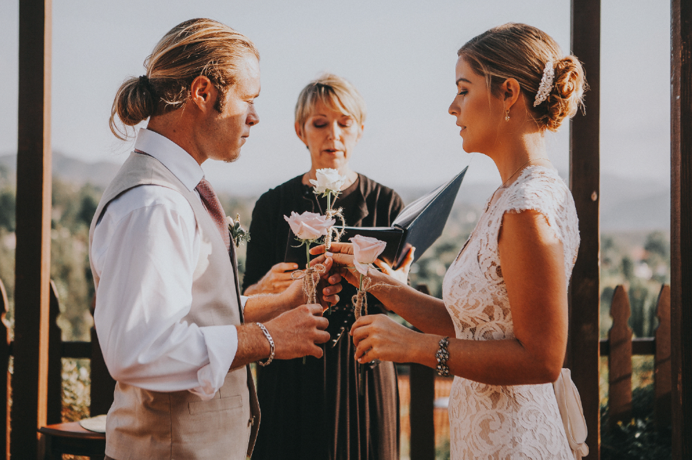 san diego wedding   photographer | bride giving rose with twine tied on stem to groom