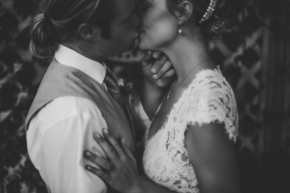 san diego wedding   photographer | monotone shot of groom kissing bride holding her chin