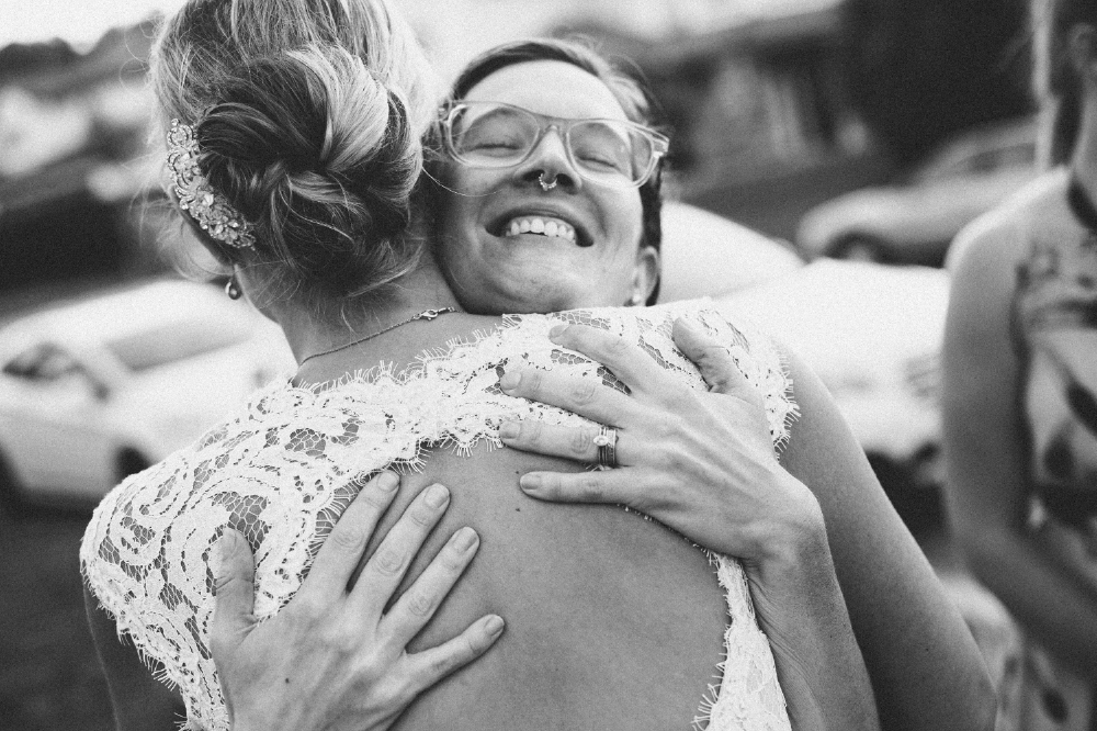 san diego wedding   photographer | monotone shot of bride hugging woman with septum piercing
