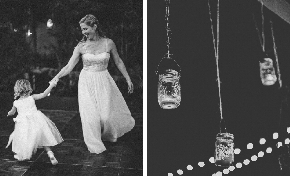 san diego wedding   photographer | monotone shot of woman dancing with child and jars hanging   from twine