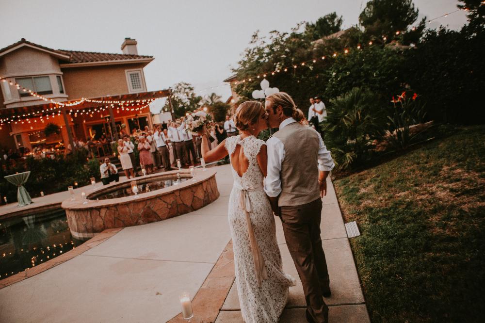 san diego wedding   photographer | bride and groom walking kissing