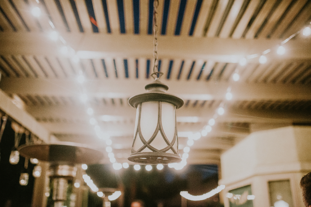 san diego wedding   photographer | lamp hanging by twine with lights behind it