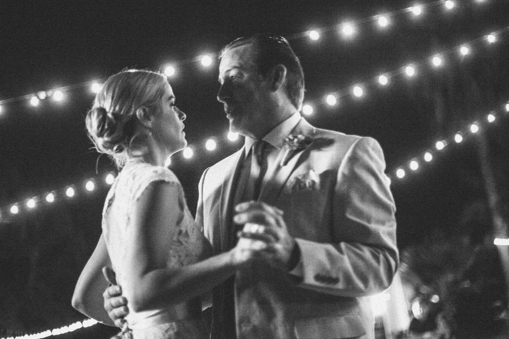 san diego wedding   photographer | monotone shot of bride dancing with father with lights behind   them