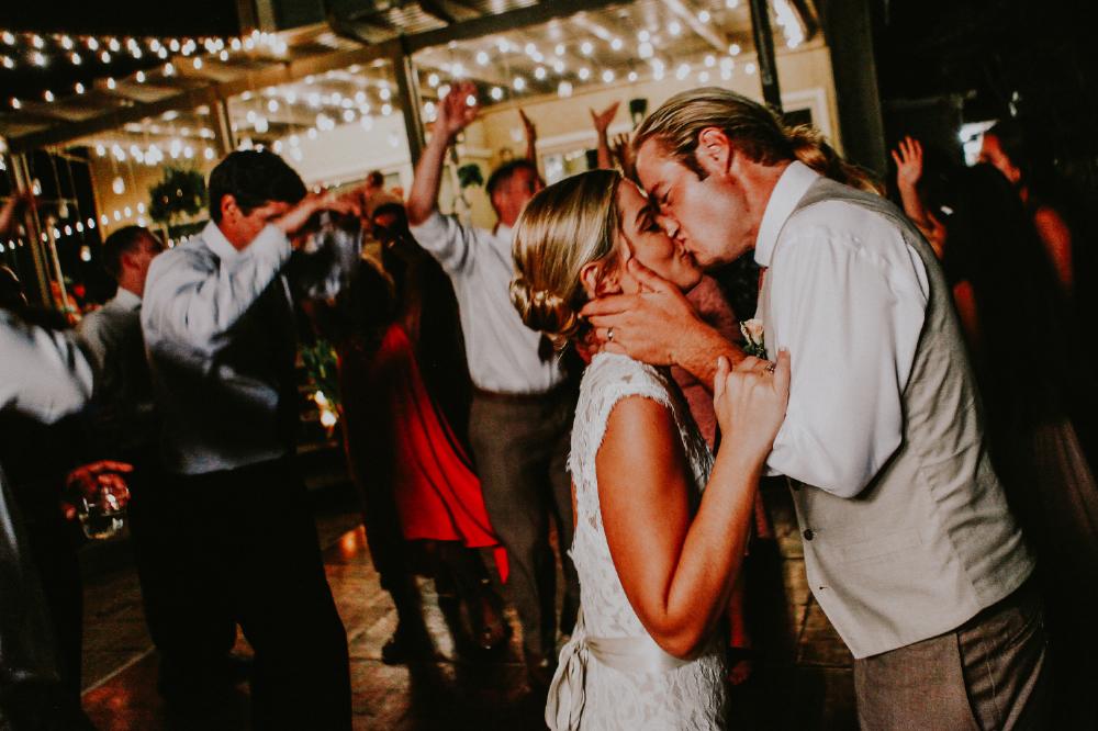 san diego wedding   photographer | groom kissing bride holding her cheeks