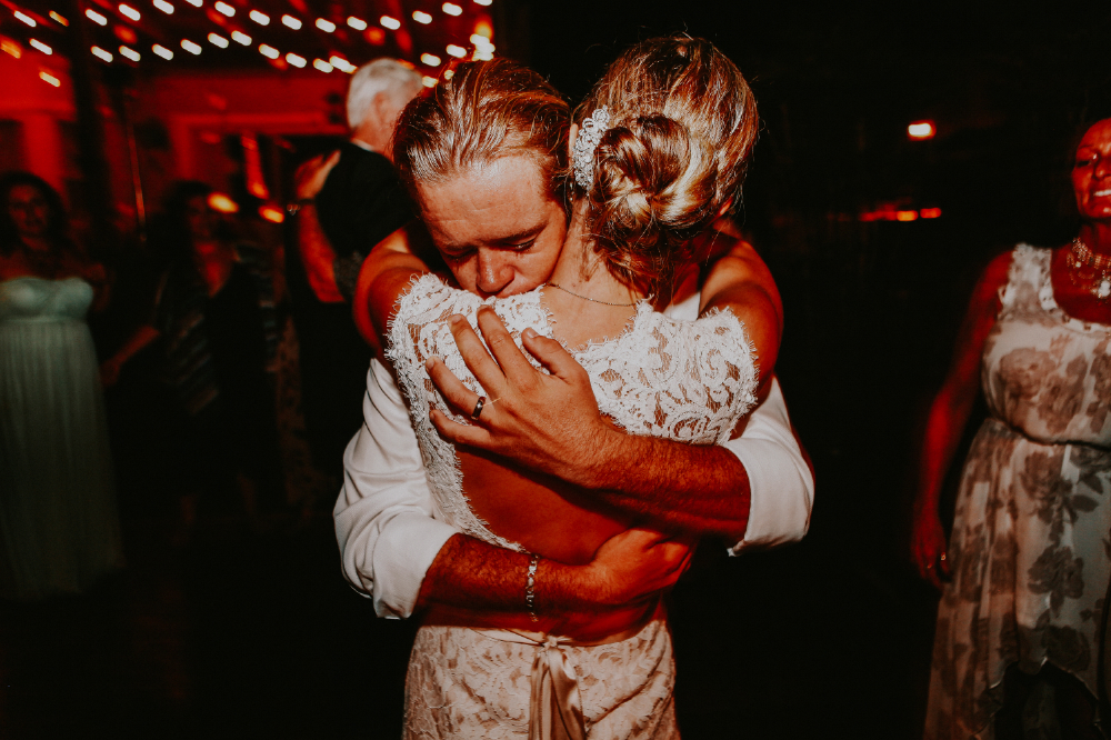 san diego wedding   photographer | groom hugging bride tightly on dance floor