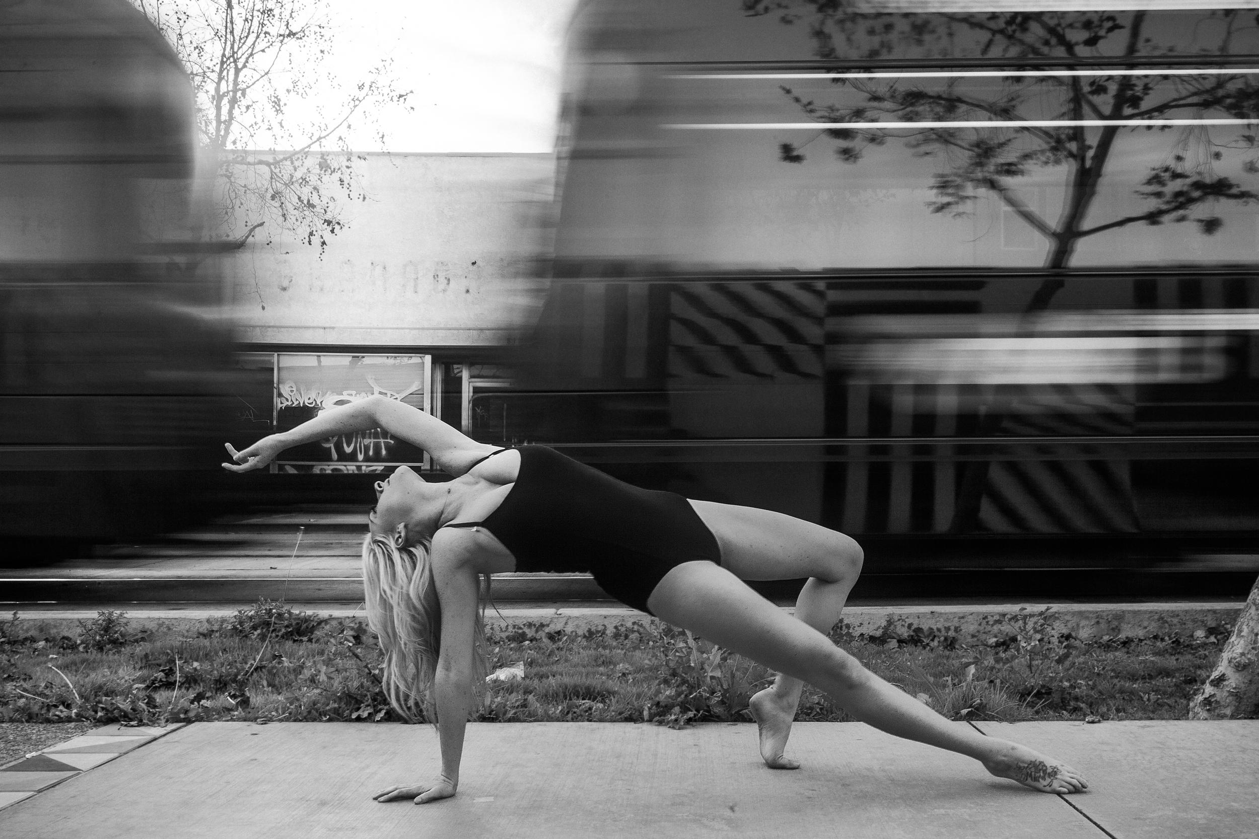 san diego wedding   photographer | monotone shot of barefoot blonde woman stretching on concrete