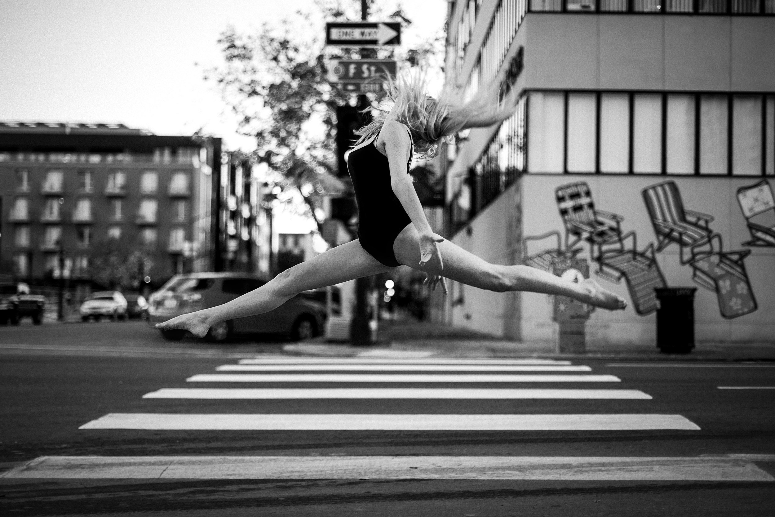 san diego wedding   photographer | monotone shot of barefoot blonde woman doing high squat on   pedestrian lane