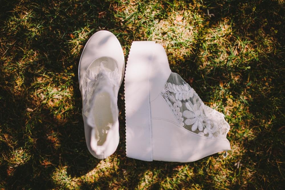 san diego wedding   photographer   white wedding shoes on the ground
