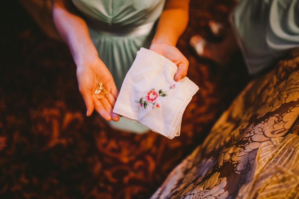 san diego wedding   photographer   woman holding handkerchief and jewelry in hand