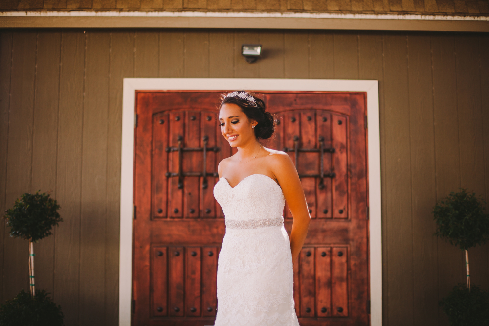 san diego wedding   photographer   woman in wedding dress standing smiling with arms behind back