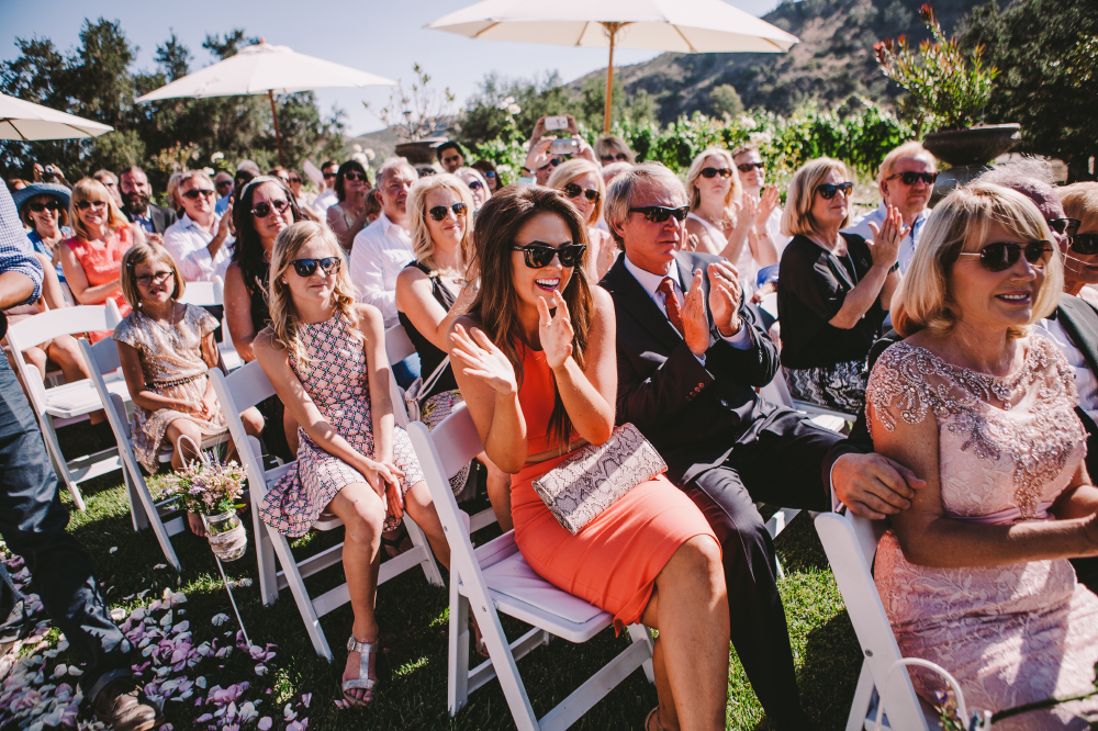 san diego wedding   photographer   happy crowd in mostly shades applauding