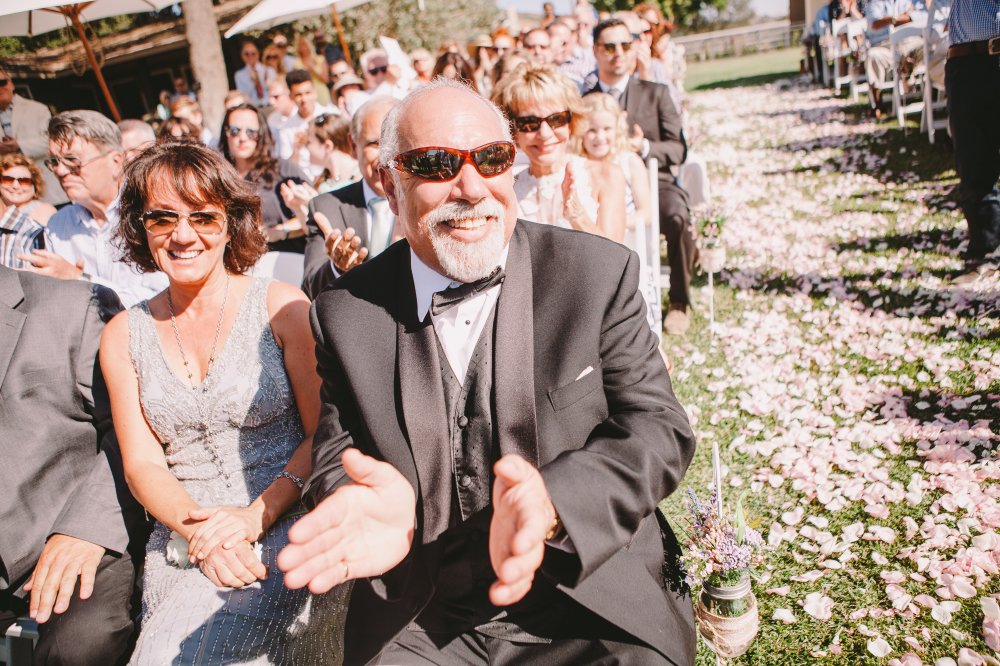 san diego wedding   photographer   crowd mostly wearing shades smiling and applauding