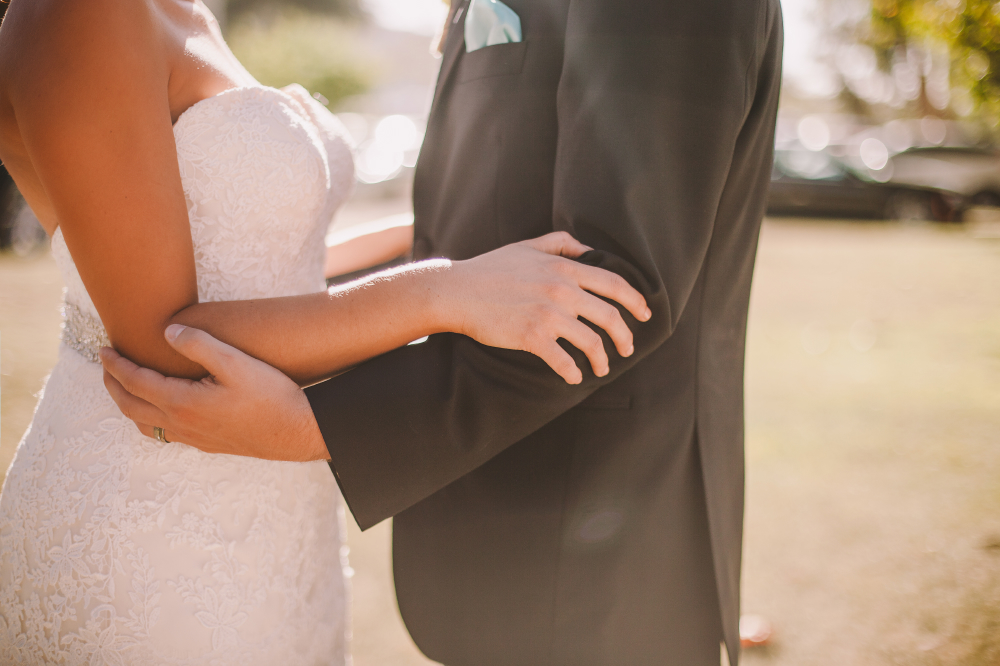 san diego wedding   photographer   closeup shot of couple's torso holding each other from the   front