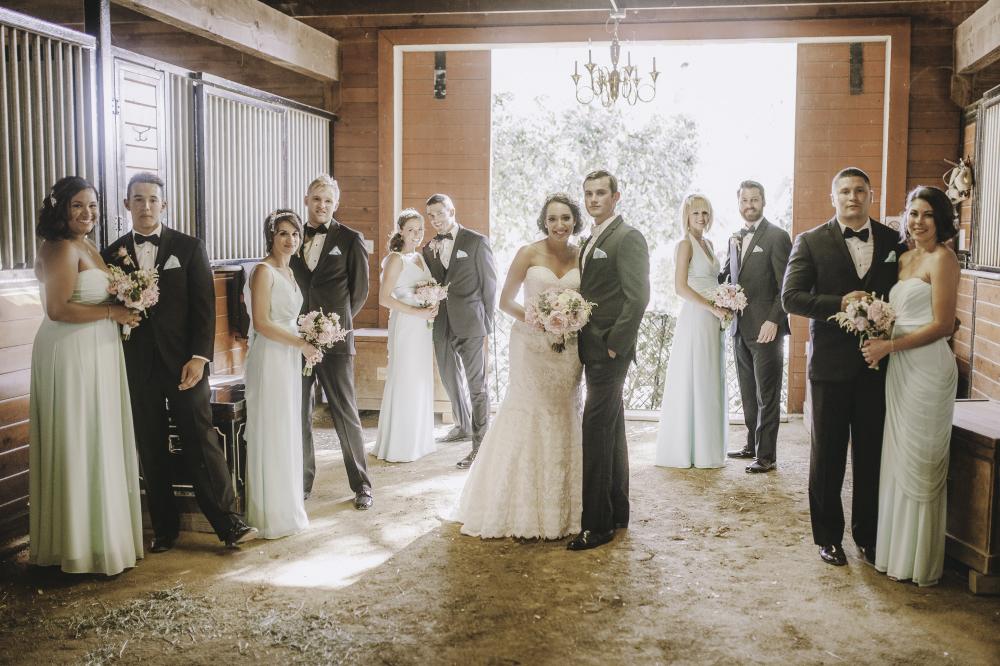 san diego wedding   photographer   pairs of groomsmen and bridesmaids in barn setting