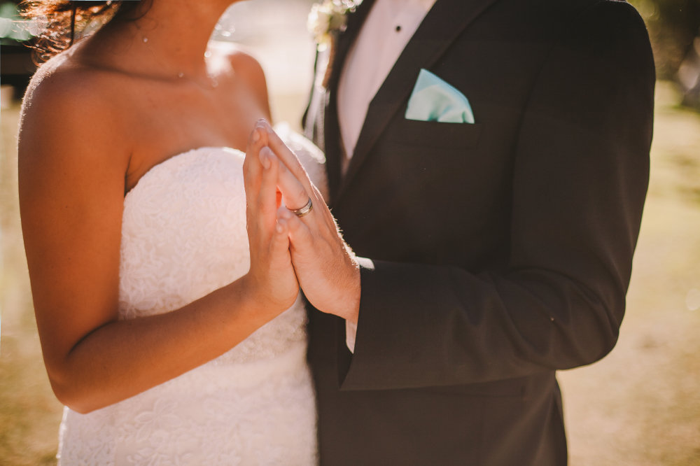 san diego wedding   photographer   closeup of newly wed couple's torso about to intertwine