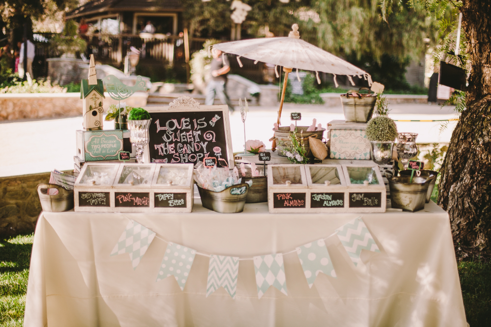 san diego wedding   photographer   table full of sweets labeled with hand drawn labels