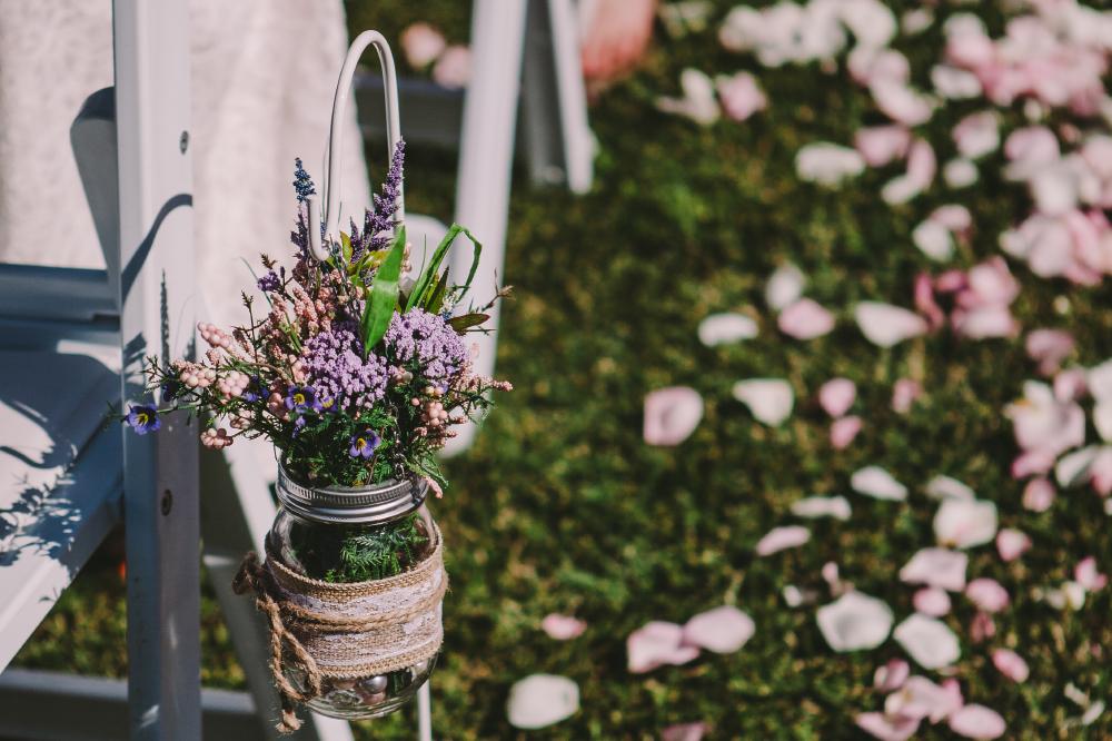 san diego wedding   photographer   flower arrangement in jar attached to chair