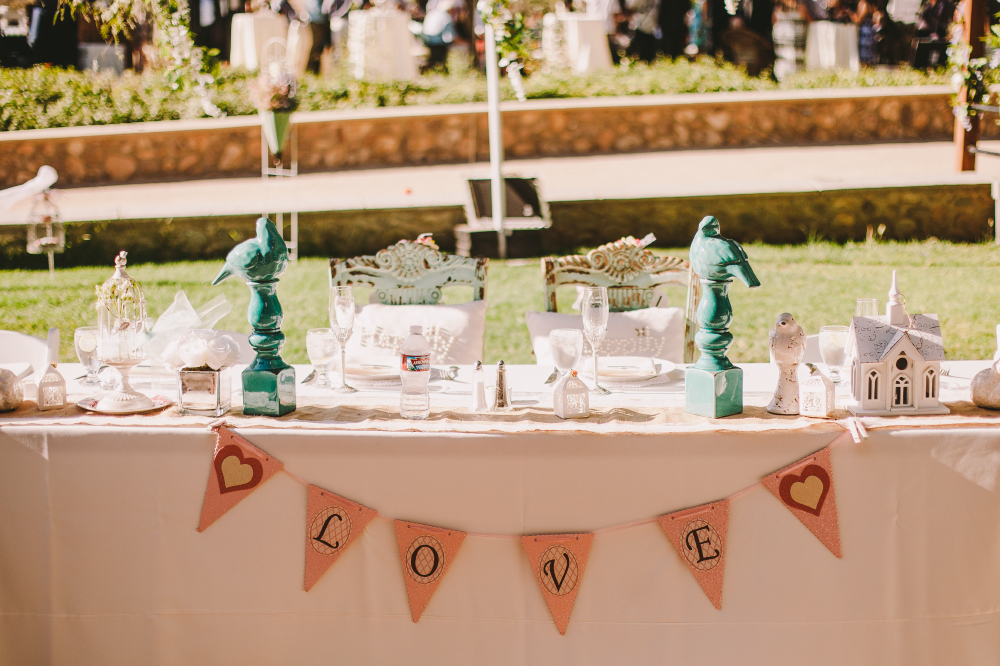 san diego wedding   photographer   table set up with streamer that says love on it