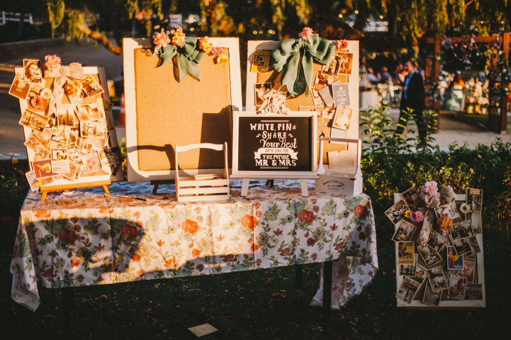 san diego wedding   photographer   table full of boards with pictures and postcards