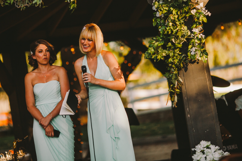 san diego wedding   photographer   blonde and brunette woman in white dresses up front speaking