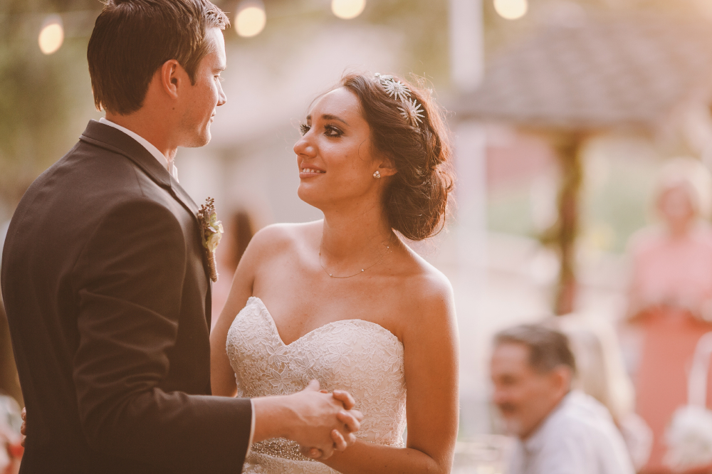 san diego wedding   photographer   bride smiling while dancing and looking into groom's eyes