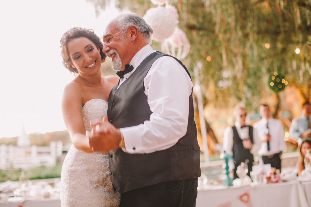 san diego wedding   photographer   bride smiling and dancing with her father holding his hand