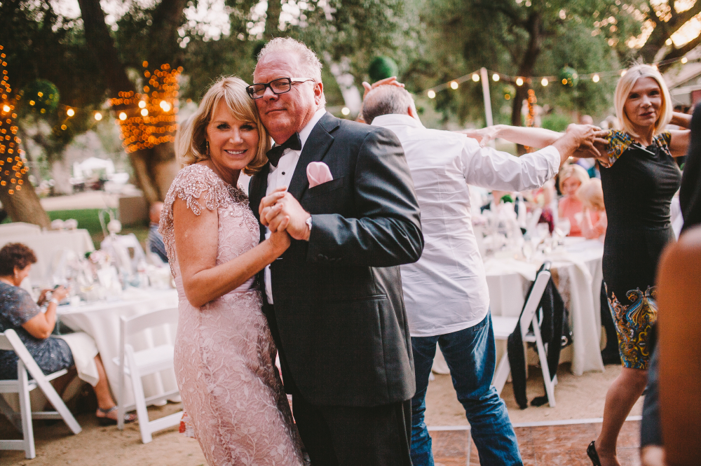 san diego wedding   photographer   middle aged man and woman dancing and looking into camera
