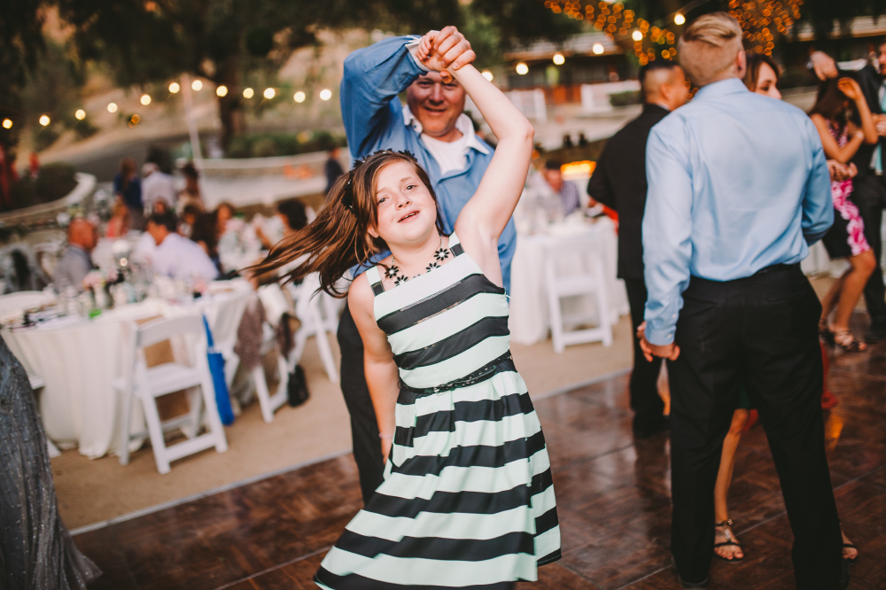 san diego wedding   photographer   child in black and white dress dancing with man