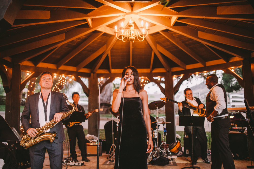 san diego wedding   photographer   band performing with woman in black dress singing