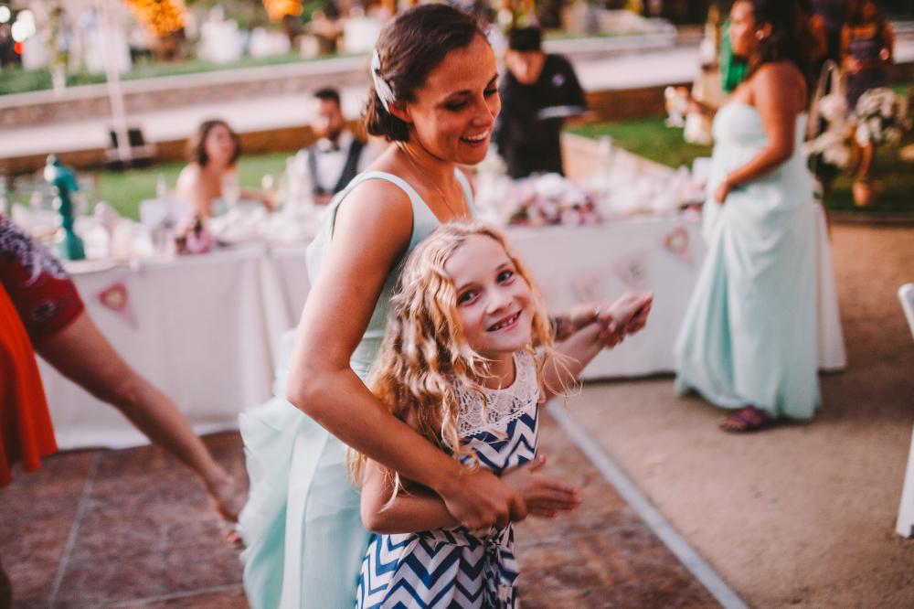san diego wedding   photographer   woman dancing with little girl on the dance floor