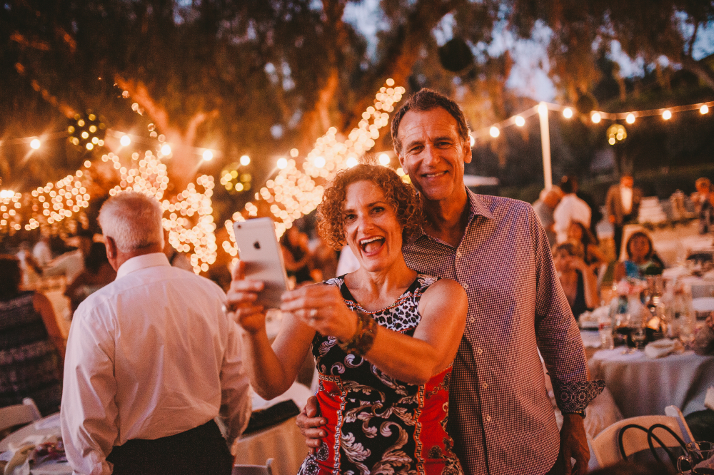 san diego wedding   photographer   middle aged woman taking a selfie with middle aged man